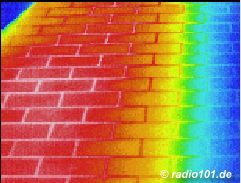 Thermographic picture - Infrarouge photograph: hot tiles on a balcony in the summertime, partially shadowed